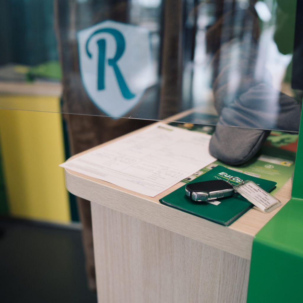 rental car key dropped off at Europcar rental desk, moose behind the counter.