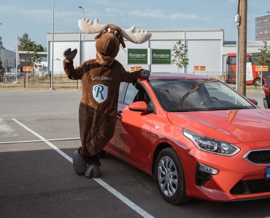 Rental Moose mascot posing with red Kia rental car. Europcar Estonia rental car fleet.