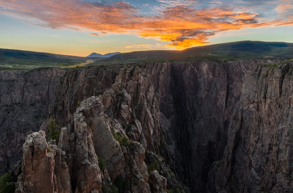 black canyon of the gunnison, stunning canyon and rock formations seen during a colorful sunset in colorado.