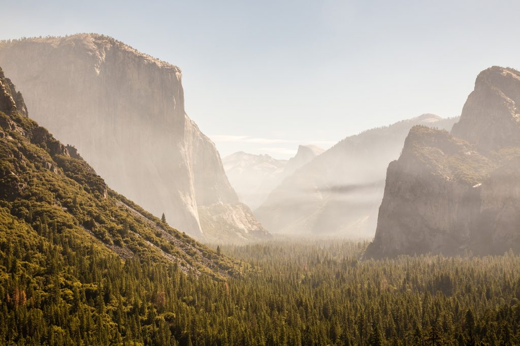 Large boulders and rock formations in Yosemite national Park seen through fog.