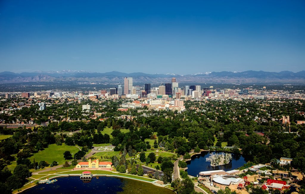 Denver colorado, often called the mile high city, seen from above. Aerial view of the city, rocky mountains in the distance, clear skies