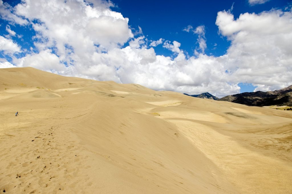 Great Sand Dunes National Park are a spectacular sight not to be missed on a Colorado road trip.
