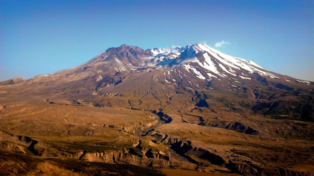 Mount Saint Helens National Monument, erupted back in the 1980s causing enormous damage to the state of Washington. Snow covered mountain seen during sunset on a clear day