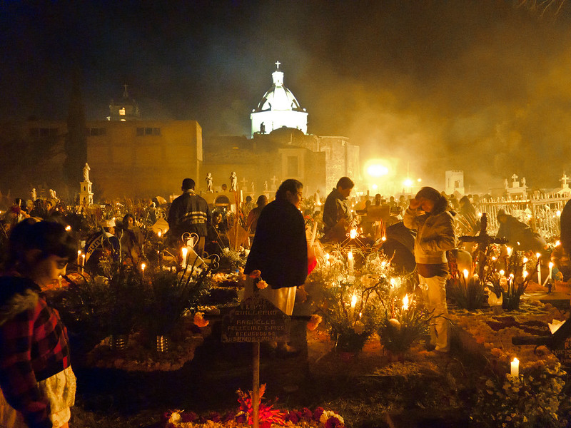 Cemetery full of people and illuminated by candles during the spectacular Day of The Dead Celebrations in Mixquic. Make sure you see these celebrations, perhaps on a day trip from Mexico City.