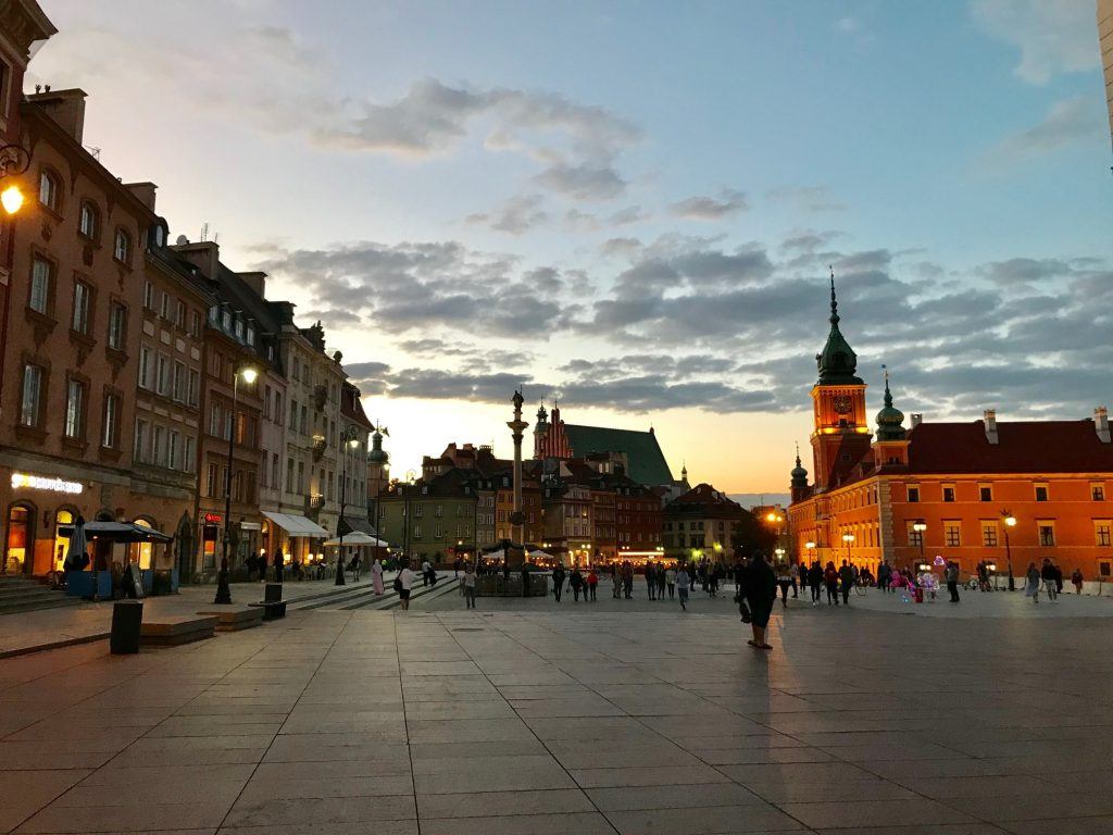 Warsaw Old Town, Zygmunt Column and The Royal Castle seen during sunset. See the best things to do in Warsaw with our curated travel guide