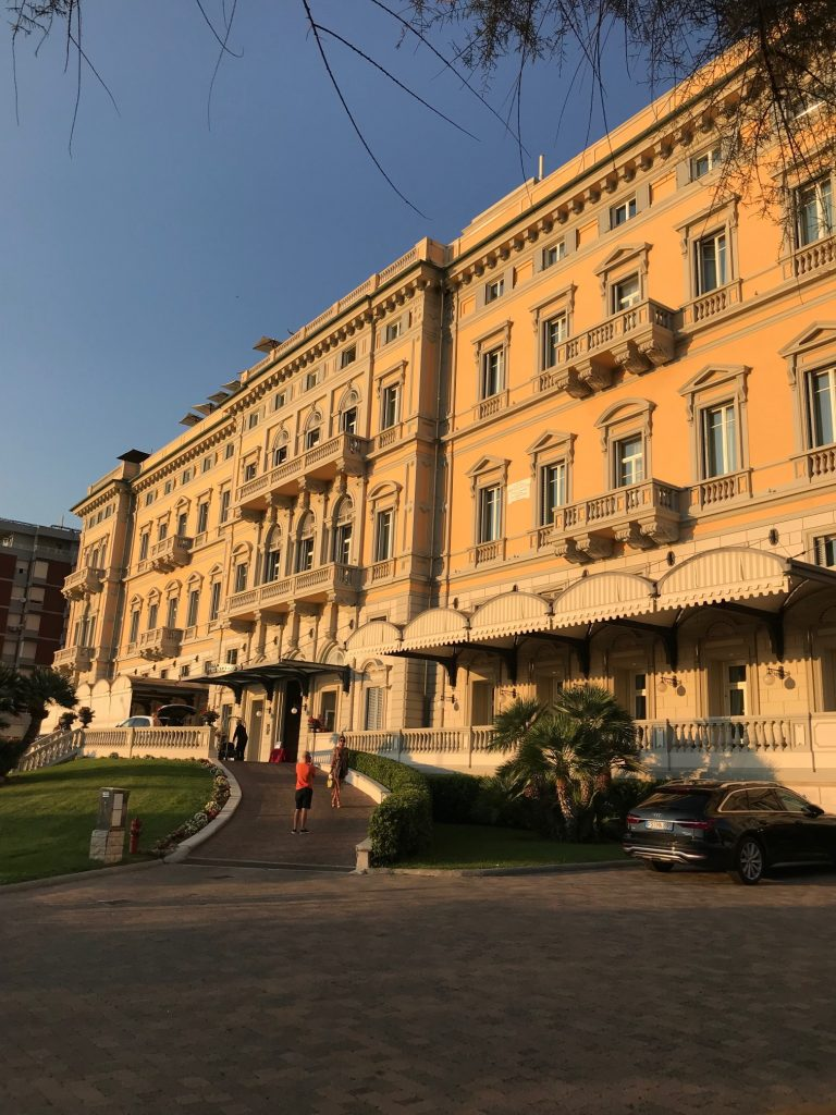 Grand Hotel Palazzo Mgallery Livorno illuminated by the sunset. the best 5 star luxury hotel in Livorno italy
