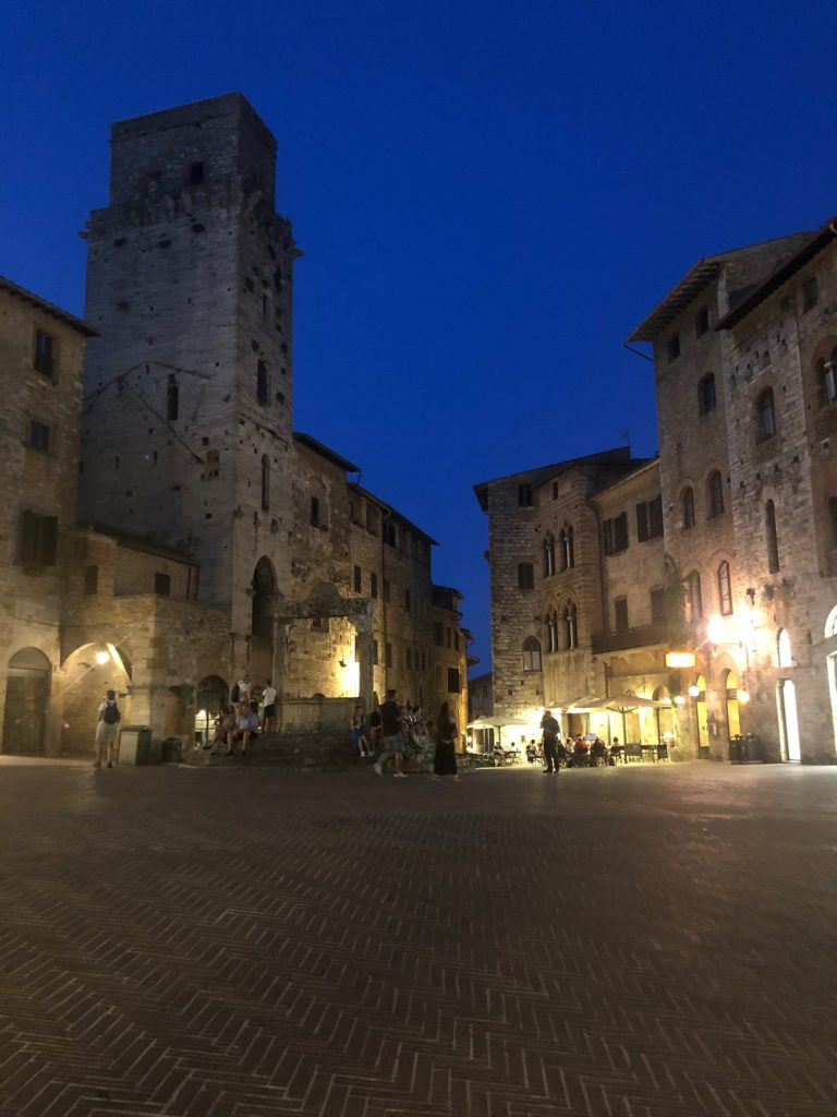 Scenic old architecture in Sam Gimignano, often called the medieval manhattan, a small town in Florence Italy. See it during our Italy road trip itinerary around Tuscany