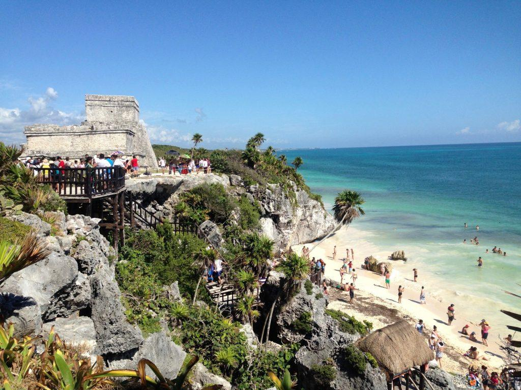 Tulum Archeological Site is a must-see on any Mexico road trip in the Yucatan Peninsula. The ruins are set in a picturesque setting, on a seaside cliff. After, visit the sandy beach below.