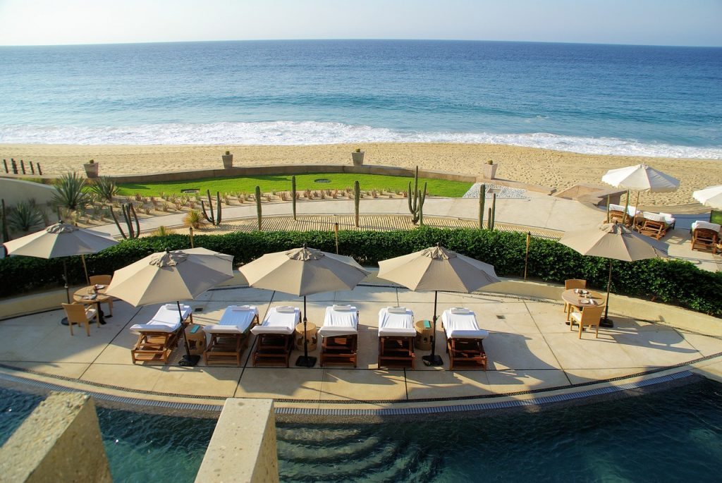 Scenic beach resort in Cabo. Chilling at a sandy beach is one of the best things to do in Cabo San Lucas.