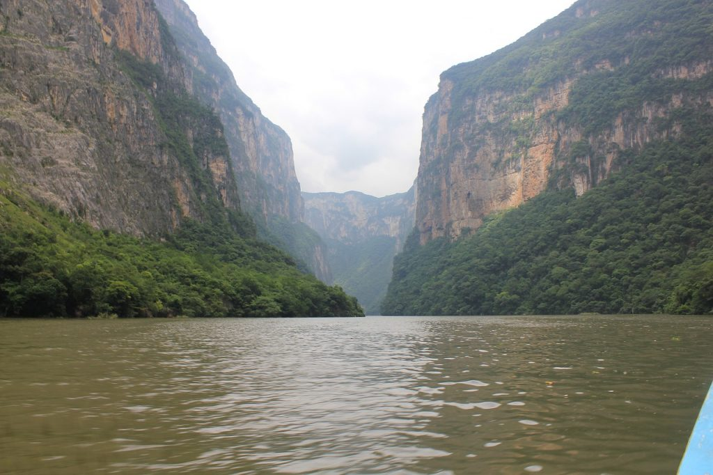 Sumidero Canyon seen from the river on a cloudy day in Chiapas, Mexico. Sumidero Canyon is one of the best attractions to see near San Cristobal de Las Casas