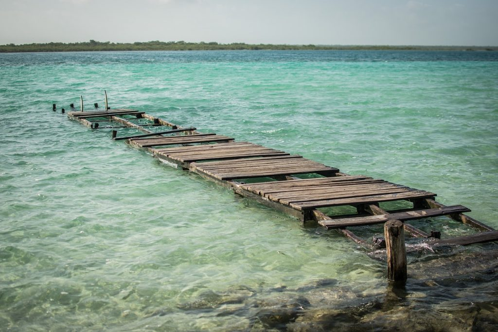 Lake Bacalar is a beautiful lagoon in souther Mexico, and a great place to see on a Mexico road trip around the Yucatan peninsula.