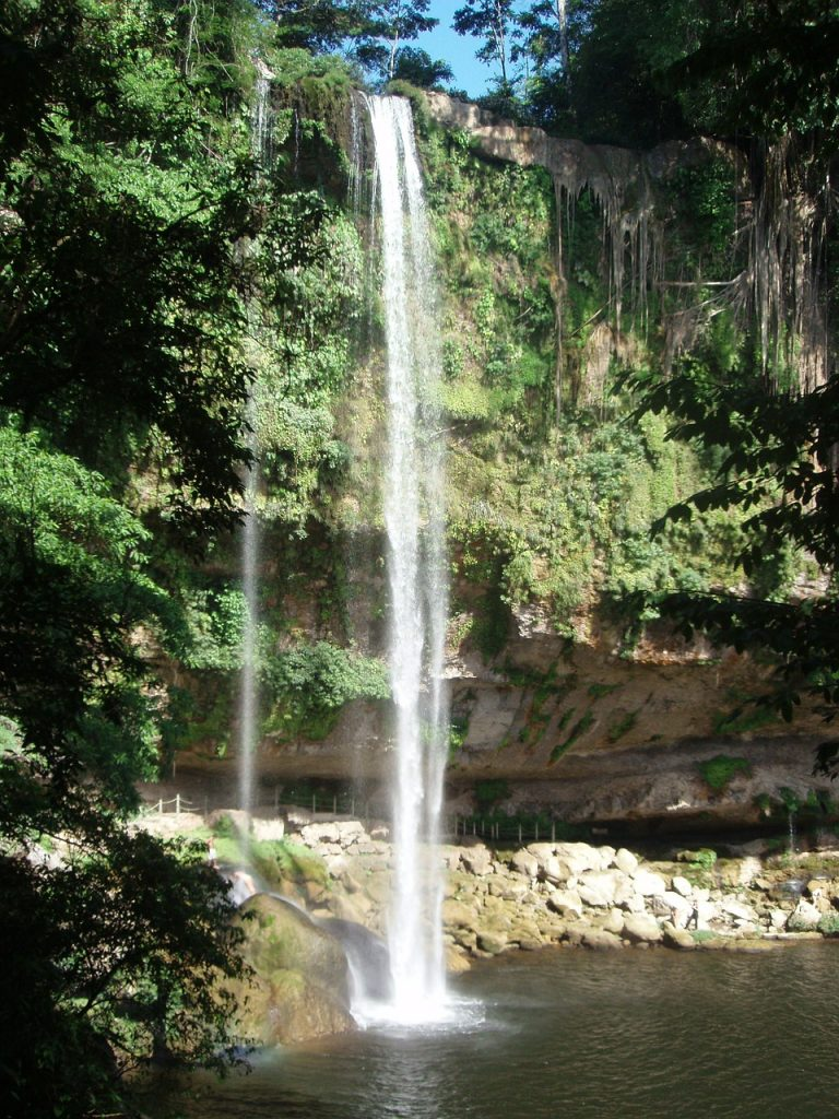 water flowing down at the misol-ha waterfalls in chiapas mexico, near palenque archeological site.