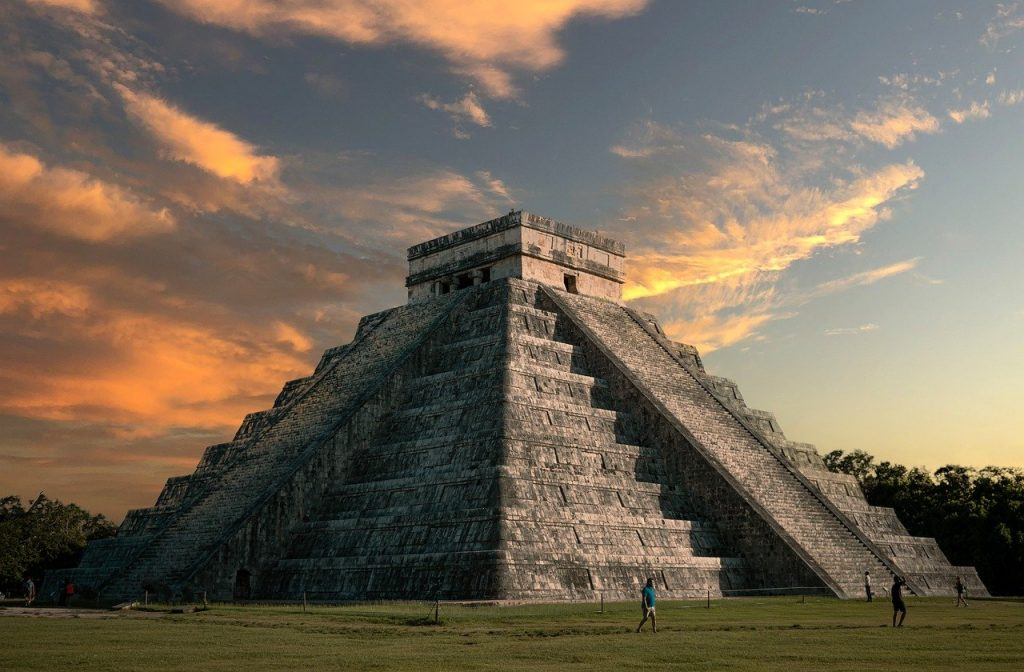 beautiful picture of chichen itza mayan pyramid during sunset, on a sunny day in Mexico. Chichen Itza is an absolute must see when visiting Mexico.