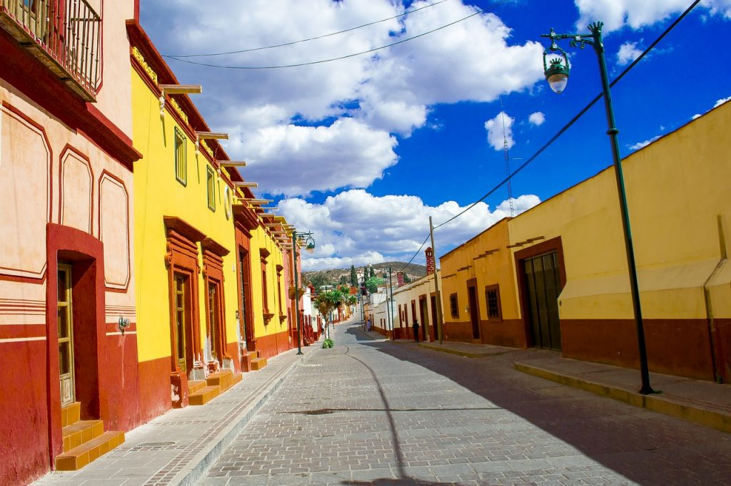 Colorful yellow facades of traditional buildings in the town of Tlaxcala, Mexico. Tlaxcala is the perfect destination for a day trip from Mexico City.