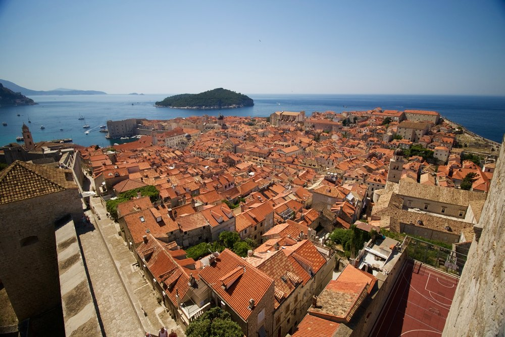 Old town of Dubrovnik seen from an elevated view point. Wonderful red roofs of traditional buildings near the Adriatic sea. Dubrovnik is a great destination to visit on a Balkan road trip