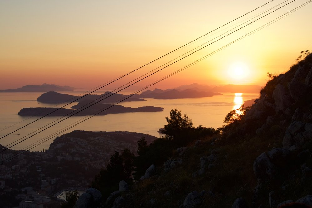 Panoramic view of Dubrovnik and its surrounding hillside area can best be seen from a cable car ride up the Sra hill. Sunset view of the Balkans
