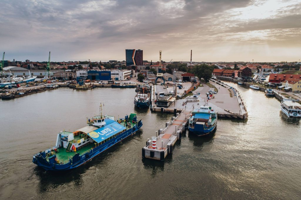 Klaipeda ferry service is the best way to get to the Curonian Spit. Ferry boat seen from above, leaving the old ferry port in the center of Klaipeda