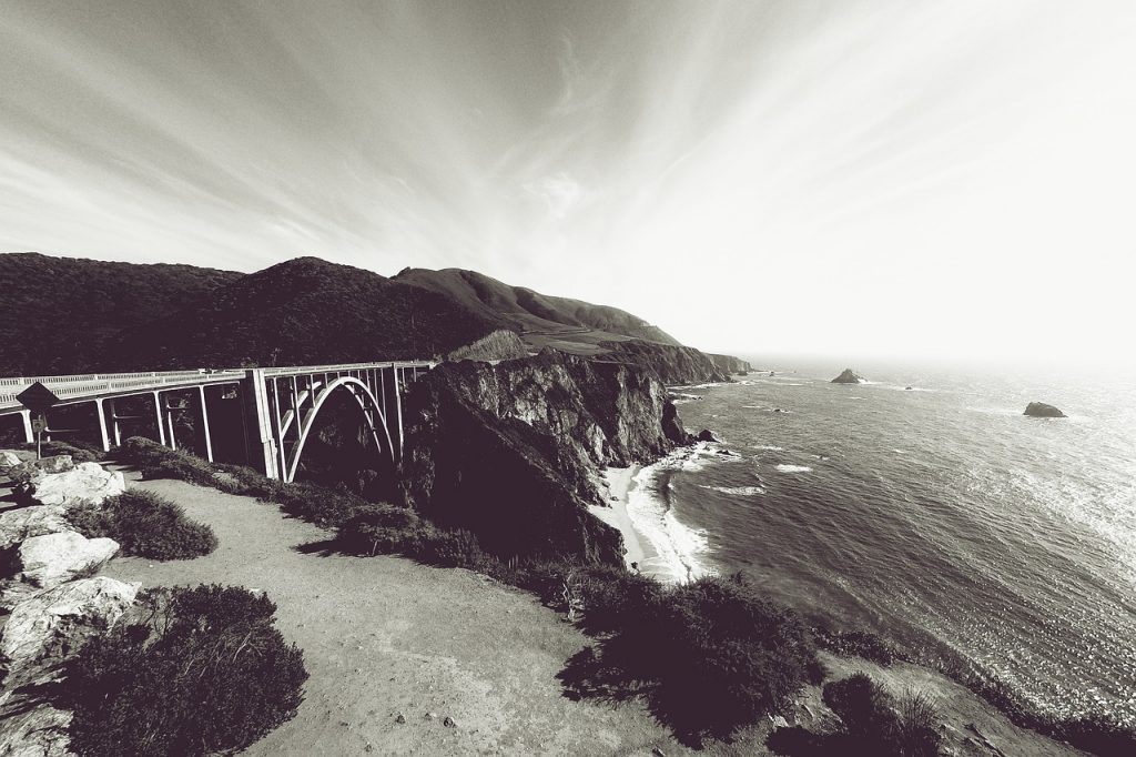 Bixby Creek Bridge is an iconic Big Sur bridge along the iconic Pacific Coast highway. This coastal drive in California is one of the best driving roads in the US.
