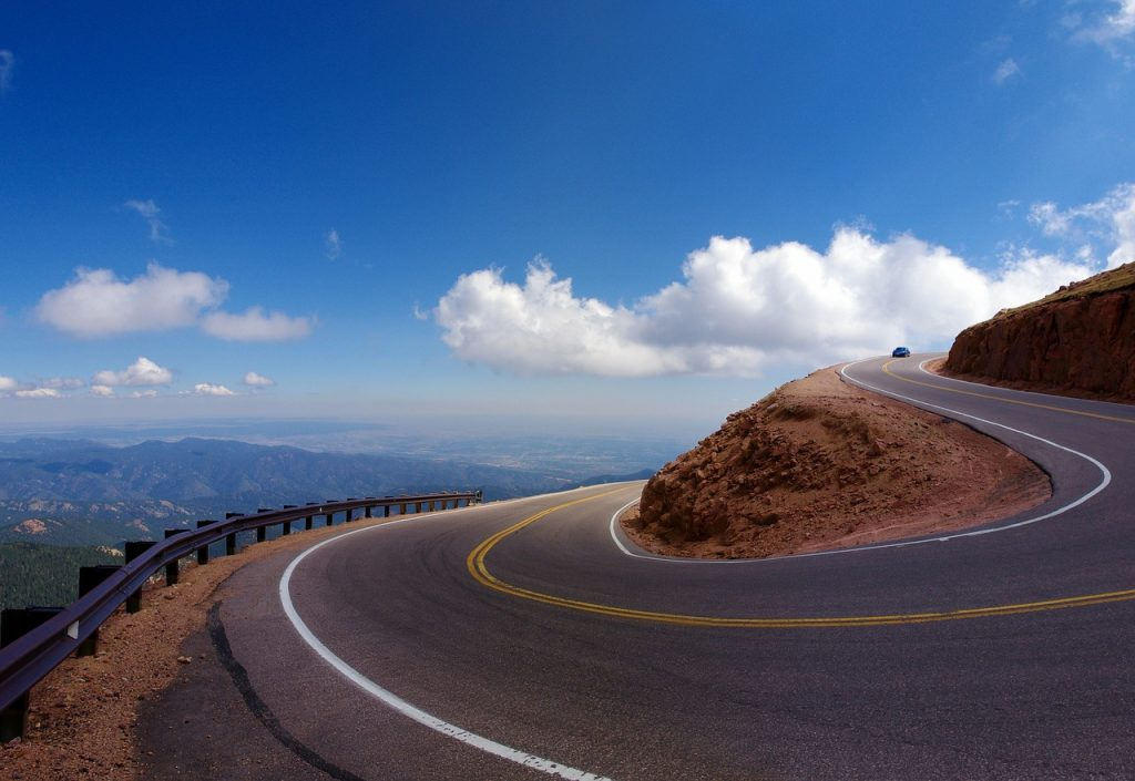 Chicane at pikes peak overlooking Colorado. Pikes Peak highway is an intesne uphill driving road in Colorado. The annual Hill Climb motor racing event is held right here.
