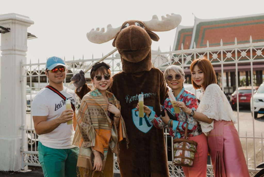 Rental Moose mascot posing with tourists in the heart of Bangkok.