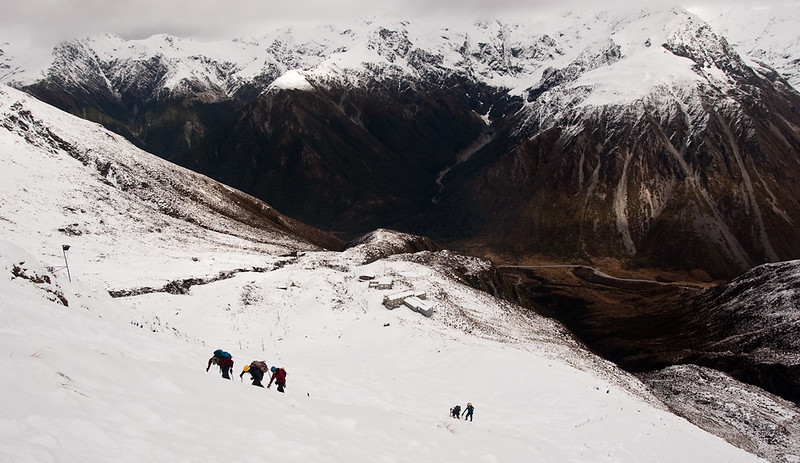 A group of climbers hiking up to the summit of Broken River in New Zealand during the winter.