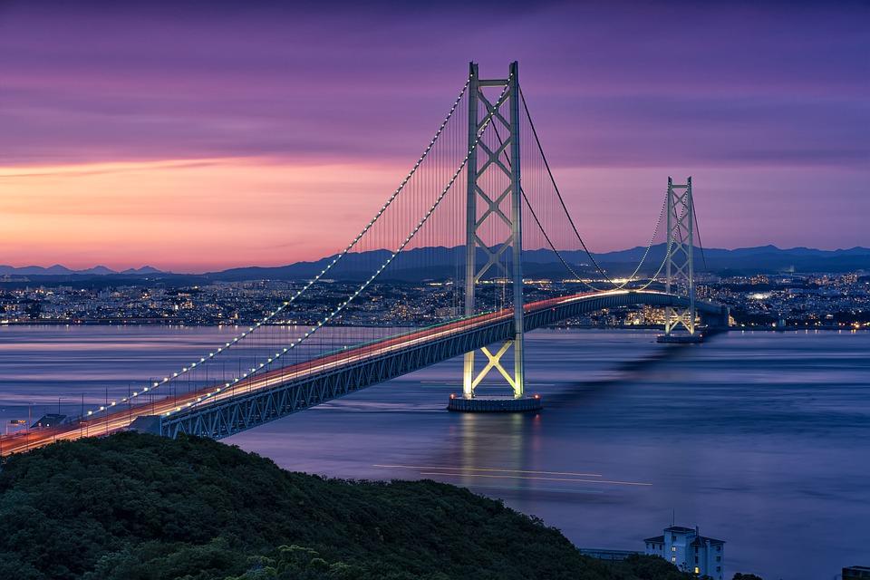 akashi kaikyo bridge, a futuristic suspension bridge in Japan, seen at sunset
