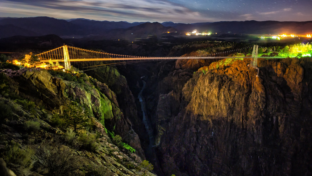 one of the most famous bridges in the US, the royal gorge bridge in Colorado, seen at night time.