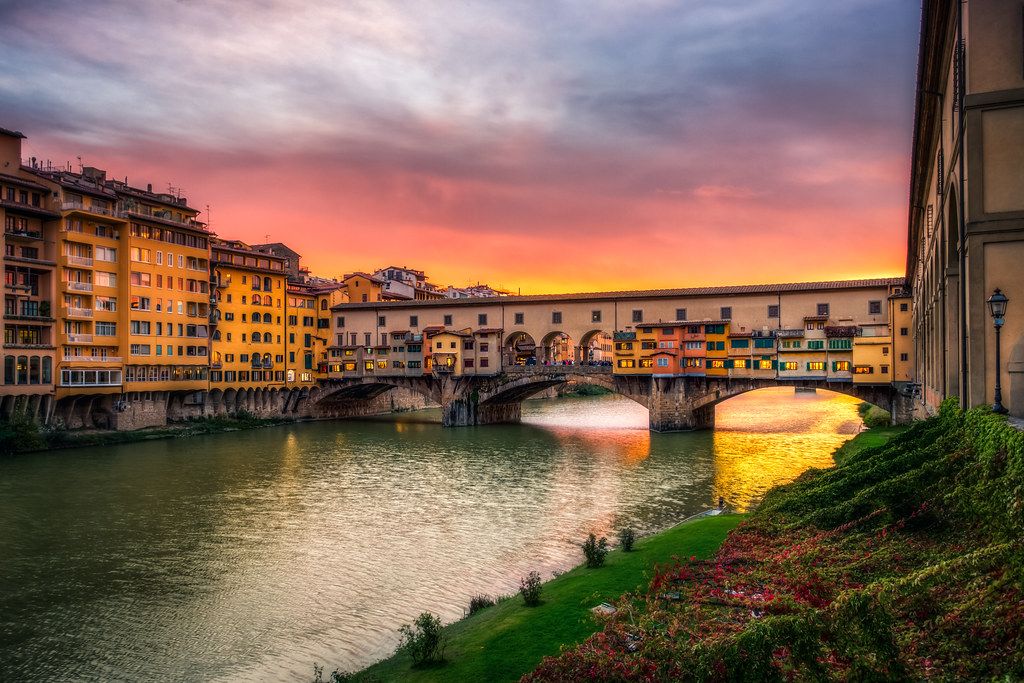 Ponte Vecchio, a famous bridge in Florence, seen during sunset