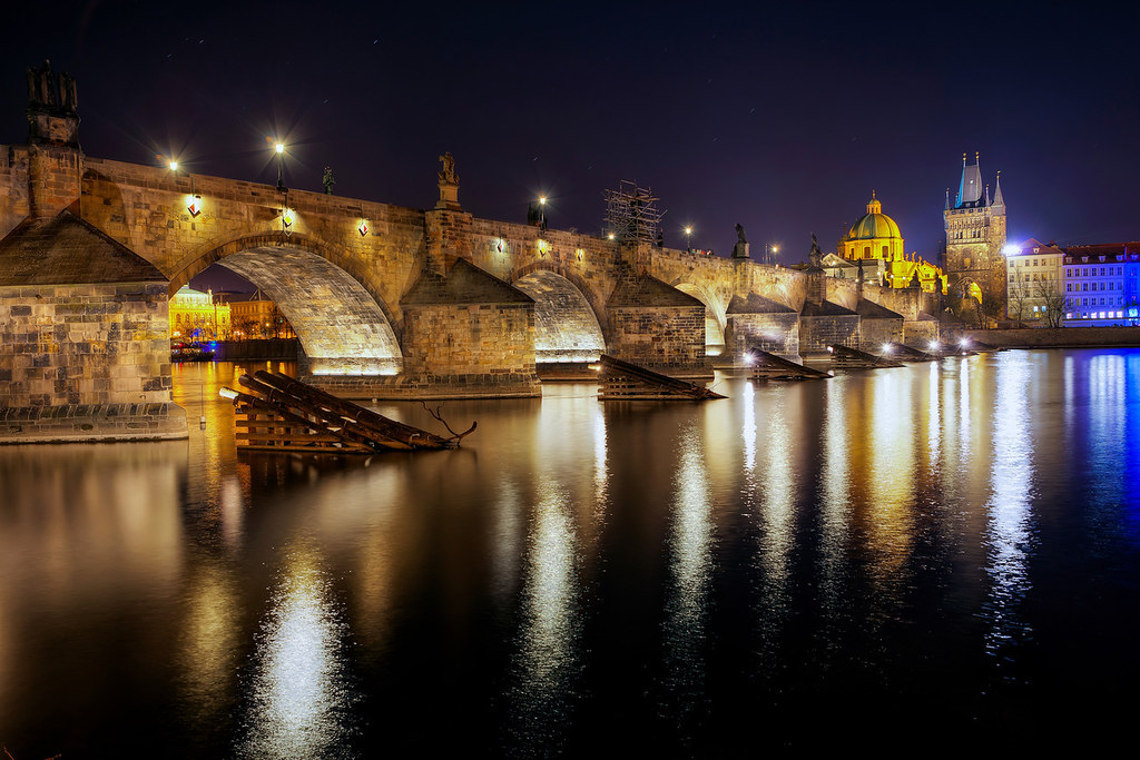 Charles Bridge in Prague connects the castle to the city's old town. Seen at night.