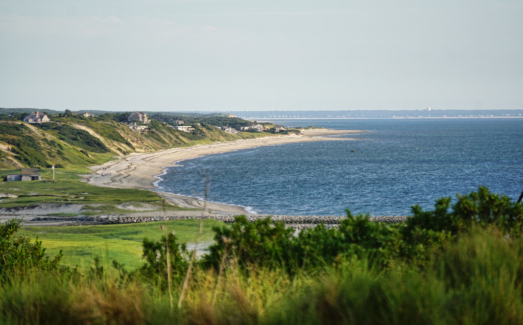 Visiting Cape Cod is one of the best day trips from Boston, MA. Sandy beach on a clear, sunny day on the East Coast.
